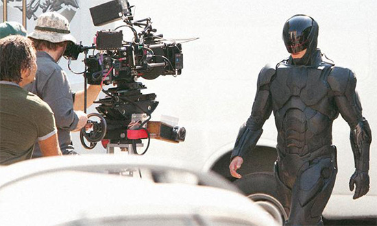 "New Robocop suit     ""RoboCop stars Gary Oldman, Michael Keaton, and Samuel L. Jackson. The film is set for release on August 9, 2013.  In RoboCop, the year is 2029 and multinational conglomerate OmniCorp is at the center of robot technology. Their drones are winning American wars around the globe and now they want to bring this technology to the home front. Alex Murphy is a loving husband, father and good cop doing his best to stem the tide of crime and corruption in Detroit. After he is critically injured in the line of duty, OmniCorp utilizes their remarkable science of robotics to save Alex's life. He returns to the streets of his beloved city with amazing new abilities, but with issues a regular man has never had to face before."" -Slashfilm"