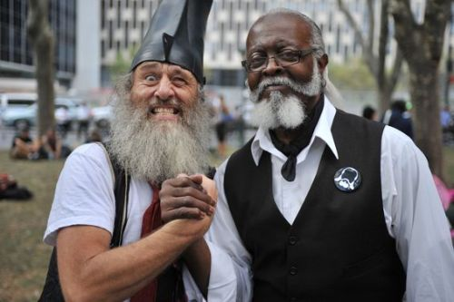 "At an Occupy Wall Street demonstration Sunday, this happened. Vermin Supreme and Jimmy ""The Rent is Too Damn High"" Mcmillan, ready for action. (Photo by C.S. Muncy)"