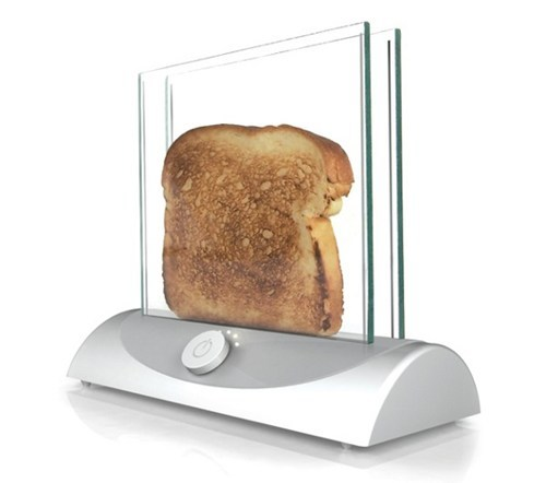 thedailyfeed:  thedailywhat:  Transparent Toaster of the Day: How is this not on shelves?! Toast-making would be epic. [incrediblethings]  Raise your hand if there's no way you'd be able to only stick bread in there.   GIVE ME THIS