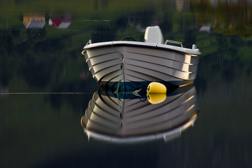Boat reflection by Jesper Hauge on Flickr.