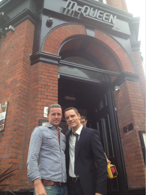 sweetpeainadysfunctionalpod:  Michael Fassbender with McQueen's owner Des | 'The Counselor' set September 17th 2012