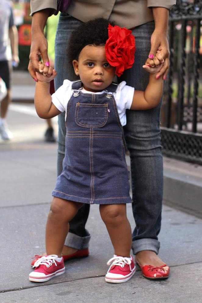 humansofnewyork:  She'll grow into it.  Wee girl. Flowering.