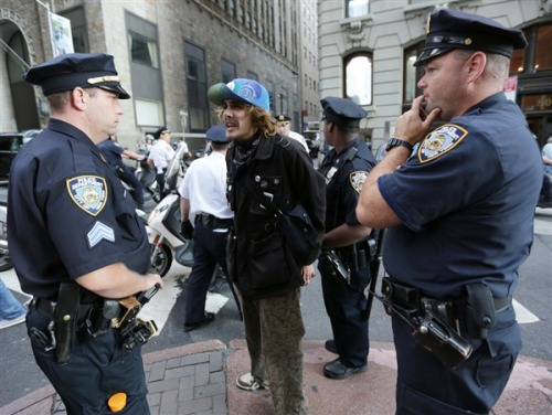"As many as 100 arrested at Occupy protest on one-year anniversary Looking to reignite their movement on its one-year anniversary, several hundred Occupy Wall Street activists protested in lower Manhattan Monday, staging a sit-in near the iconic New York Stock Exchange and swarming through the streets in costumes and toting American flags and signs. Roughly 100 protesters were believed to have been arrested, including some rabbis and pastors who had sat down in the street and sidewalk, blocking them, said protester Michael Aaron, who helped organize the demonstrations and was keeping an arrest tally. A police source said multiple arrests occurred at multiple locations.  ""We're just at year one. We have a really big mountain to climb. But we're hoping to get the power back to the people,"" said Kim Fraczek, 37, who wore an Obama mask. She was with a man, Erik McGregor, 44, who had on a Romney one. They said they were aiming to show the two were controlled by money. ""In our bipartisan system, when the two candidates for presidency are doing everything to kneel down to the corporations and banks and turn against the people, it doesn't matter who you vote for, because the war machine will continue,"" said Fraczek, a handbag and jewelry designer. SOURCE: NBCnews"