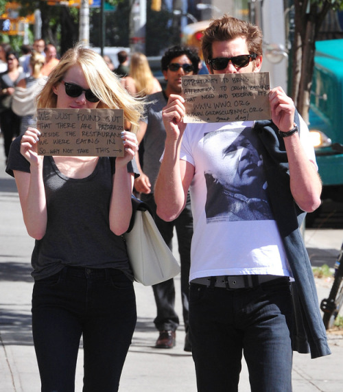 Andrew Garfield and Emma Stone turn an unwanted paparazzi intrusion into a promotional opportunity for two charities.