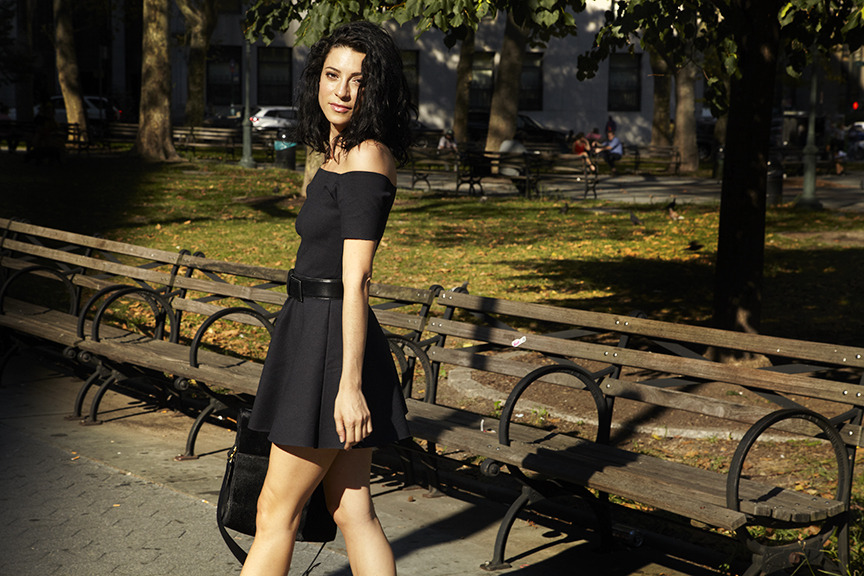 Reformation Creative Director Yael Aflalo wearing our Oyster Dress in black. Available online and in store.