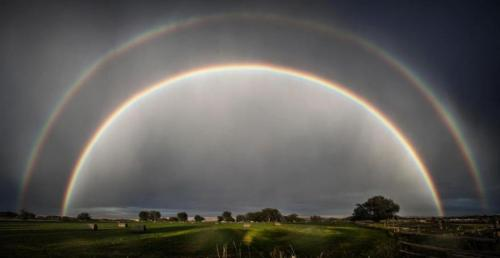 "Amazing Photo: Double Rainbow Over Wyoming  Wyoming resident Jonmikel Pardo took this spectacular photograph of a double rainbow on Sep. 1. from his backyard in Lander, Wyo.  ""It was just after a fast-moving thunderstorm passed through,"" he told OurAmazingPlanet. ""There was a break in the clouds just as the sun was about to set behind the mountains.  The break was large enough to allow the full sunlight through and the rainbow was incredibly bright, even more so with the dark storm surrounding us."""
