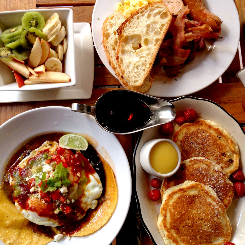 lapelouse:  A most epic brunch for two, this past Sunday @ Almond: huevos rancheros, lemon ricotta pancakes with lemon curd & strawberries, eggs bacon chicken sausage, fruit. Almond | 12 East 22nd Street NY NY 10010