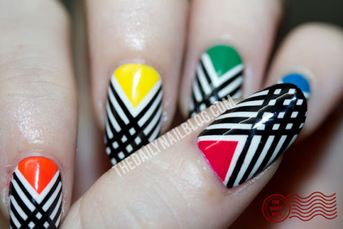 thedailynailblog:  Have I Crossed the Line? When you look at this post, you might think, hey- that looks familiar!  (probably because if you follow this tumblr, you'll remember it from yesterday- at least part of it!) I loved the thumb design so much from the Earning My Stripes manicure, that I decided to do a full manicure like it, but using multiple 'moon' colors. :) See Full Post (with more pictures and products used)