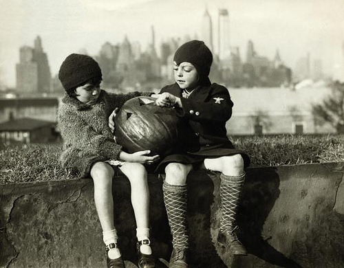 fuckyeahvintage-retro:  Children carving face into pumpkin. Governors Island, NY (1930s) © Underwood