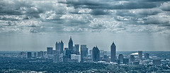 Atlanta Skyline by Carson Matthews  Taken from the 45th floor of the luxury condominiums of the Sovereign in Buckhead. Even a cloudy day in Atlanta looks beautiful through the eyes of an artist with a camera:)
