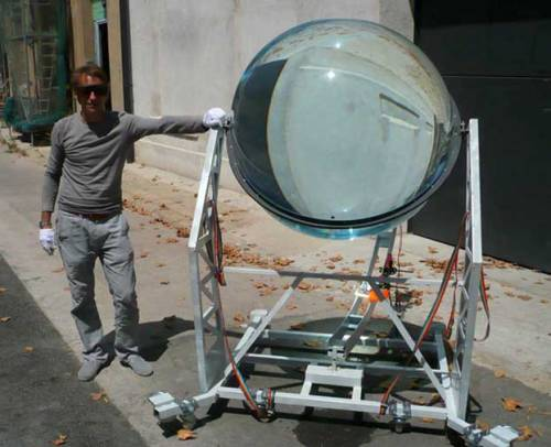 stufftoblowyourmind:  discoverynews:  Giant Marble Harvests Energy from Sun and Moon  It looks like a giant, glass marble. But this globe is no game. It's a sun-tracking, solar energy concentrator. This sun-tracking glass globe is able to concentrate sunlight and moonlight up to 10,000 times and that the system is 35 percent more efficient than traditional photovoltaic designs that track the sun.  cool…  Next, construction beings on a giant Hungry, Hungry Hippo. /Robert