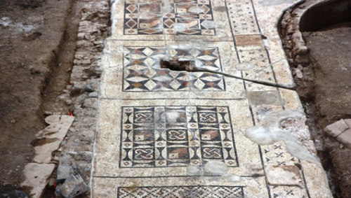Roman mosiac discovered under farmer's fieldThe 1,600 square feet mosaic would have fronted an open-air marble swimming pool flanked by porticos.