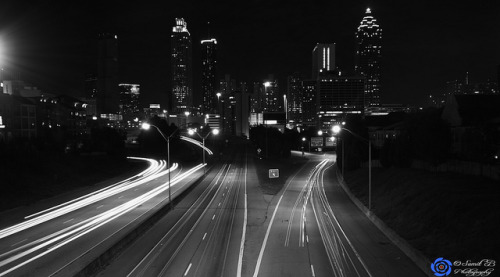 Atlanta Sky Line by Samy Sumit Black and white photograph of the Atlanta skyline at night taken from the highway. If Atlanta traffic would only MOVE this quickly all the time :)