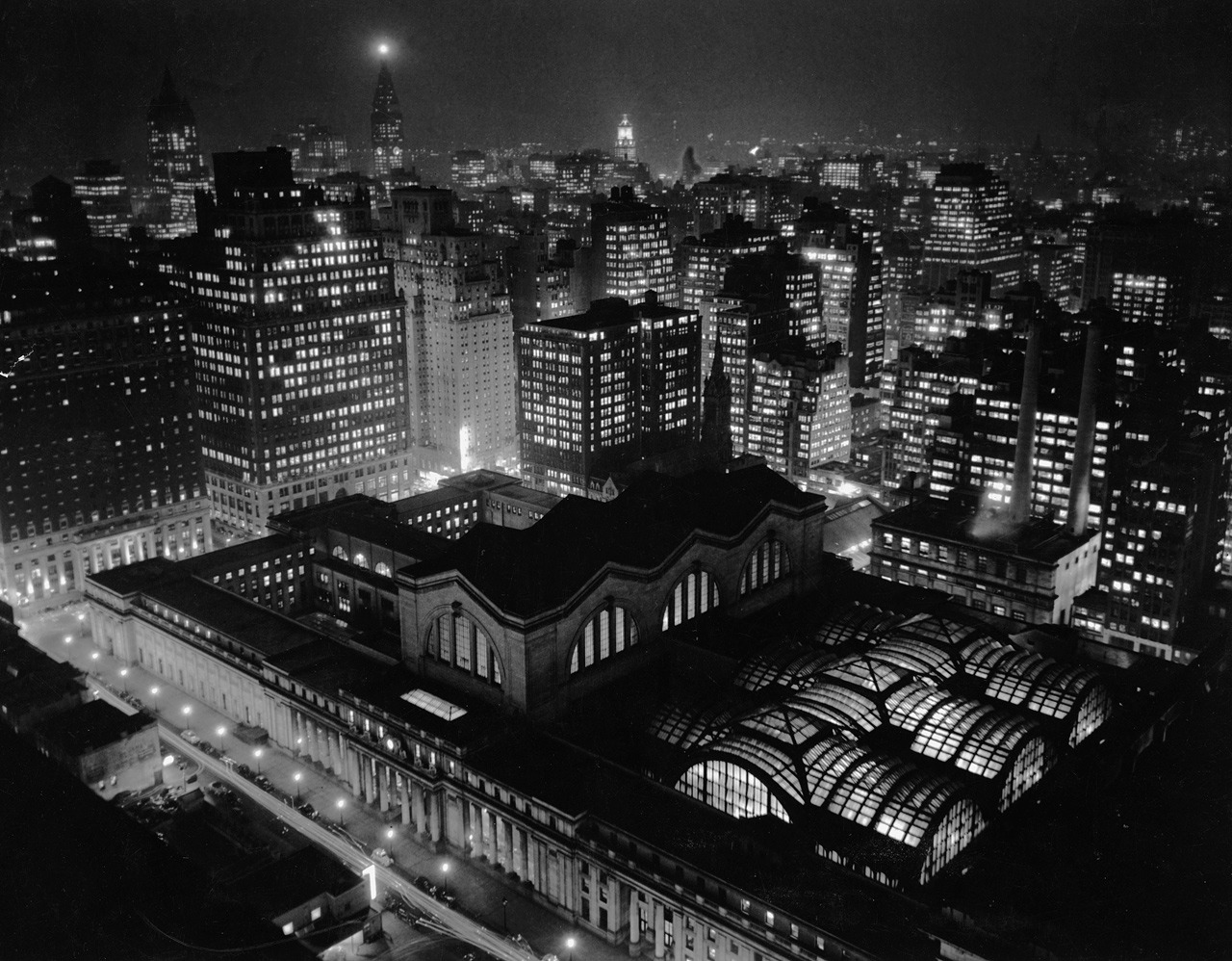 ckck:  Nighttime view of New York City's Pennsylvania Station from the top of the New Yorker Hotel, circa 1939-1940. View bigger.