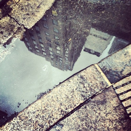 I complain about the rain today, but I still love #nyc! #puddle #reflection #rain #texture #city (Taken with Instagram)