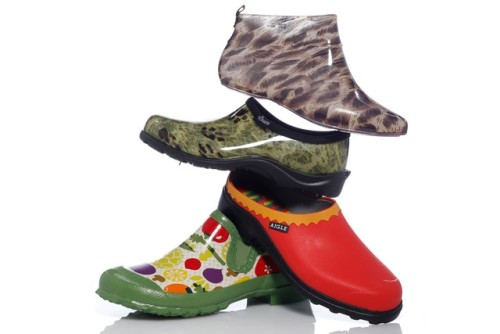Rainboot Trend: Easy-Off Styles From top: CAPELLI's leopard-print ankle style; SLOGGERS' camouflage clog with rugged outsole; a two-tone clog with lug bottom from AIGLE; and a garden-print clog with side goring from BOGS