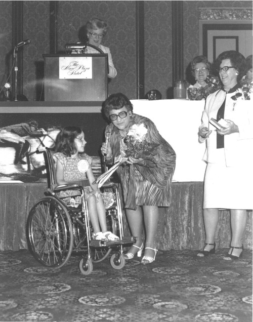 In Wisconsin — President Viola Moltzen pinning Muscular Dystrophy State Poster Child. National President, Vi Moltzen, and Community Service Chairman appeared on the Jerry Lewis - Love Network Telethon and presented before a Nationawide audience a check in the amount of $261,000 to Jerry Lewis, the special project.