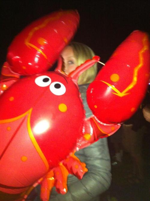 GPOYW: ROCK LOBSTER! The B52s were surprisingly awesome last weekend, and my girl friend snagged a balloon! Note the down parka. During the days, it was sundress weather. And then the sun shut down and it got really really cold. Like, Waking-up-to-a-thick-layer-of-frost-on-our-tents-every-morning cold. Brrr. [Telluride Blues & Brews Festival, Telluride, Colorado, September 14, 2012]