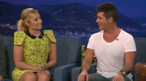 Did anyone else get a strange vibe from Simon Cowell and Demi Lovato during the first episode of The X-Factor USA last week? Something about their interactions rubbed me the wrong way. In the same way that Lifetime movies occasionally rub me the wrong way.  So I suppose what I'm trying to say is that this is my moment of truth.  Despite the fact that Simon Cowell is old enough to be Demi Lovato's estranged great-uncle, he flirted with her as if they're peers. As if they're not 32 years apart. See the interview where they flirt right here
