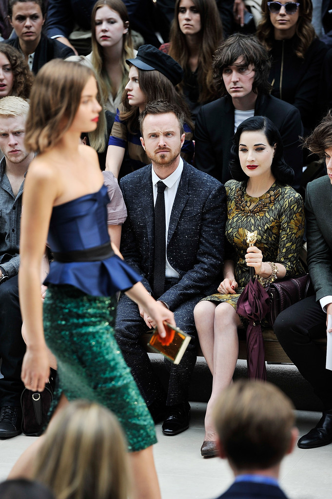 suicideblonde:  Aaron Paul and Dita Von Teese at the Burberry Prorsum Spring/Summer 2013 show during LFW, September 17th  The look on Aaron's face is PRICELESS!