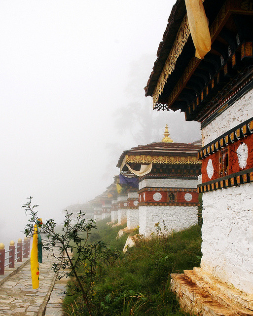 visitheworld:  Buddhist stupas in the mist, Bhutan (by danjahn).