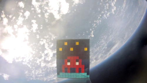 jtotheizzoe:  A Space Invasion Street artist Invader sent one of his trademark tiles into space. Your move, Banksy. (via Wooster Collective)
