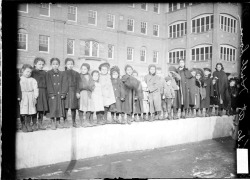 Portrait of children standing in a line on the grounds of Hull House, West Polk Street near South Halsted Street, in the Near West Side of Chicago, 1908. Photograph by Chicago Daily News. Want a copy of this photo?  > Visit our Rights and Reproductions Department and give them this number: DN-0005531. Connect with the Museum