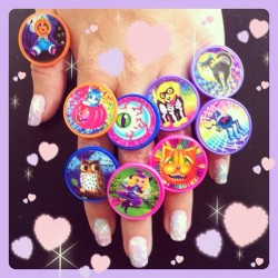 ammeb:  How amazing are these Halloween Lisa Frank rings I got yesterday? Tacky chic✨💘 oh and my DIY pastel galaxy nails 💅 (Taken with Instagram)  Don't forget to enter our Halloween Lisa Frank Giveaway! (considering doing a 2nd giveaway with some of these rings if I can find them at Target. What do you think??
