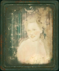 Lawhimsy: Photomatic Image. Photomatics are a vintage photo that is set into a metal frame and people would hand them out to friends and loved ones.
