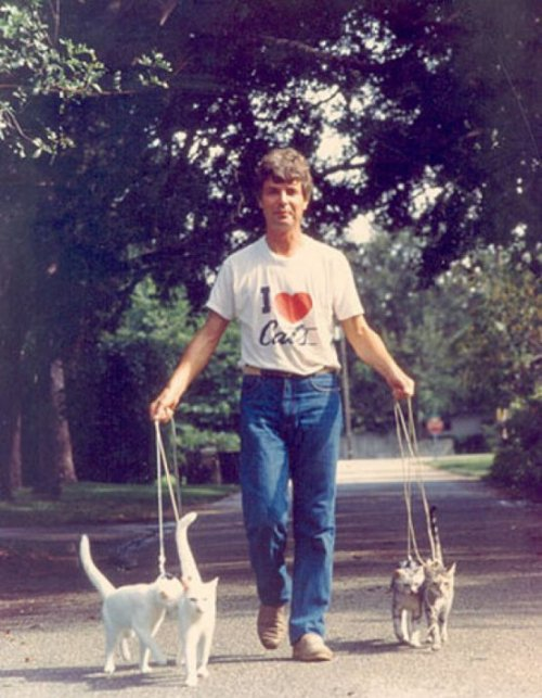 "Guy Takes His Cats for a Walk Oddly enough, he wears his ""I Walk Cats"" shirt while he's loving them."