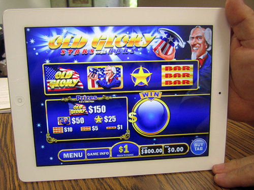 The Minnesota Gambling Control Board approved electronic pull-tab gambling this morning. A new iPad-based version of the tradtional pull-tab games could start today at bars and restaurants that run charitable gambling. The gambling could start in as many as five locations overall by the end of the day. State officials say 2,800 bars and restaurants in Minnesota could be eligible for the games this year. The state is expecting the games to bring in as much as $72 million in new revenue. That money will be used to pay the debt on the state's share of a new $1 billion stadium being built for the Vikings in Minneapolis. The state has pledged about $350 million to the construction. Read more about electronic pull tabs from reporter Tim Nelson
