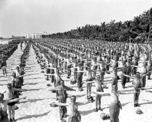Soldiers performing exercises on Miami Beach. With gas masks. Not creepy. 1945.