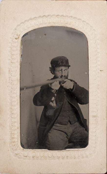 ca. 1860-90's, [trompe l'oeil-esque tintype portrait of a bearded gentleman taking aim at his target] via Cowan's Auctions