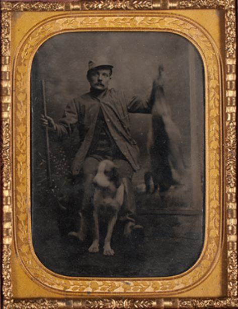 ca. 1860-90's, [tintype portrait of a hunter, proudly displaying his kill, and his dog] via Cowan's Auction