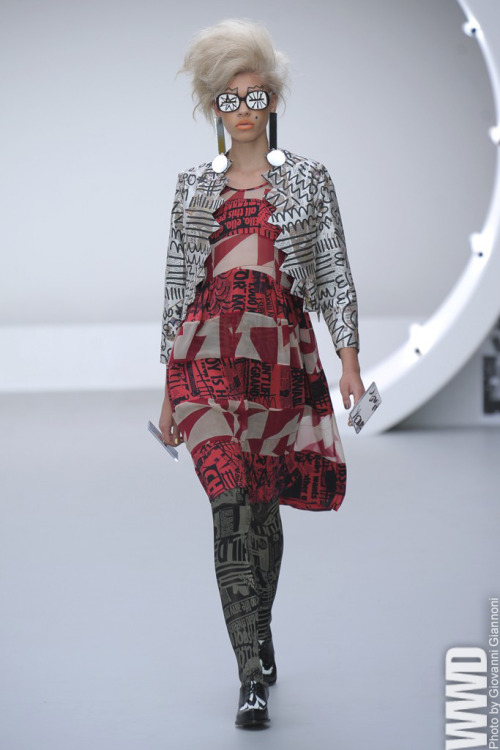 Louise Gray RTW Spring 2013 The designer splashed images of newspaper print covered in multicolored scribbles onto dresses, shirts and hosiery.  For More See all of WWD.com's RTW Spring 2013 Runway Coverage