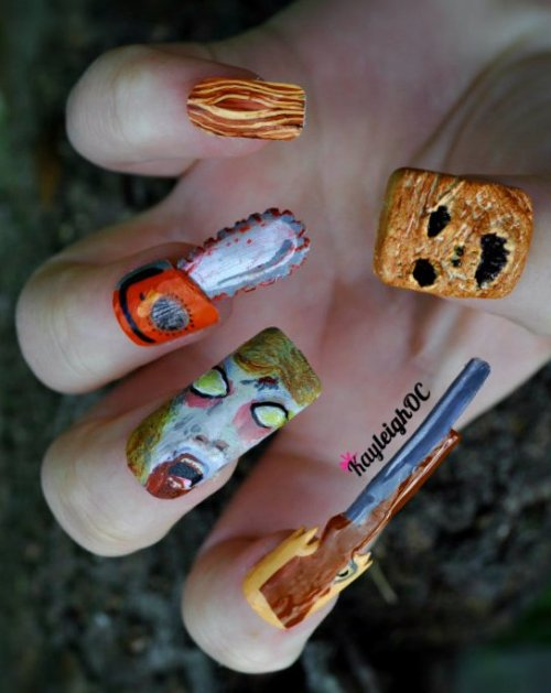 ampersandsetc:  kayleighoconnor:  Evil Dead nails :)Made these last night and am so pleased with them, the Evil Dead films are some of my favourites!The Book of the Dead (or the necronomicon) thumb nail is made from clay (I think I might turn it into a necklace once I've worn them) and the rest are just normal false nails (painted with a mix of varnishes and acrylics).The deadite (supposed to be Cheryl but I'm no good at faces) middle nail is probably the most detailed nail I've ever tried, but was only through total luck that it turned out sooort-of alright).The index finger is a 'boomstick', the ring finger is a chainsaw and the little finger is just a wood-y design (I was thinking the rape-y tree - or just that the first two films are set in the woods/wood cabin).I did attempt a severed hand but it turned out rubbish.  WANT.