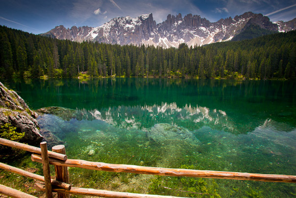 The rugged Dolomites and the colorful Karersee Lake in South Tyrol, Italy. Photo by Schlarmage, Matador member.