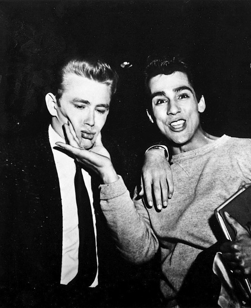 jamesdeandaily:  James Dean and friend Perry Lopez on the set of Rebel Without a Cause. I wish I could have squeezed Jimmy's cheeks, and not the ones on his face.
