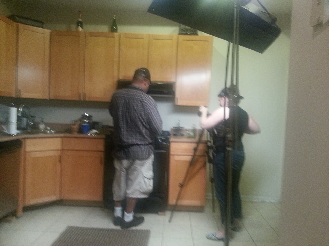 On set for our brand new music video.  One of our actors, Mr. Pippen, cooks up trouble alongside our director of photography/editor Jayme Joyce.  All of the lights.  All of the lights.