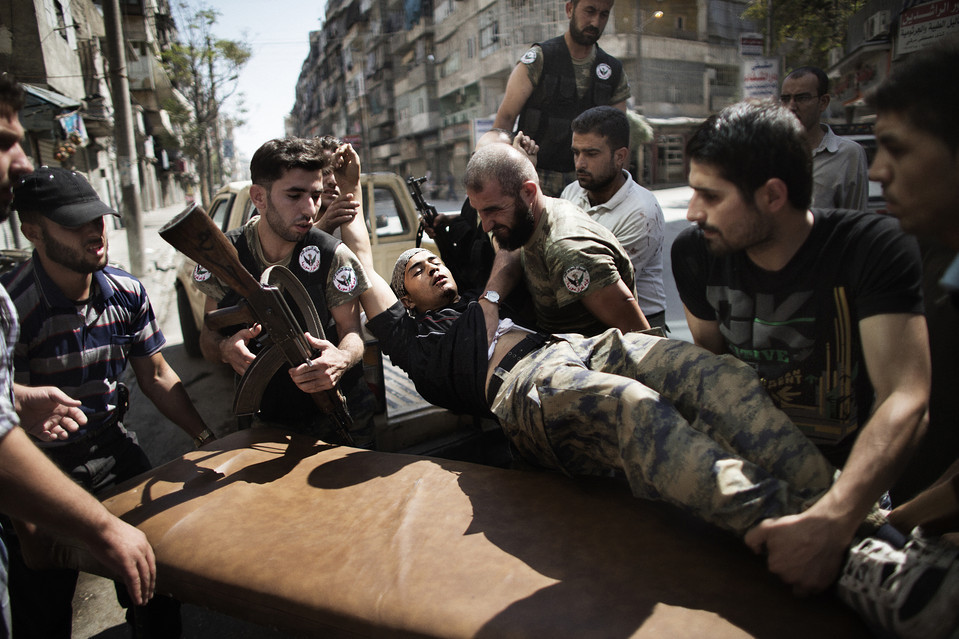 Rebels helped a comrade who survived a Syrian army strike in Aleppo, Syria, Tuesday. Government troops shelled several districts in Aleppo and clashed with rebels, as Damascus ally Iran proposed a simultaneous halt to the violence and a peaceful solution to the conflict. Marco Long/Agence France-Presse/Getty Images