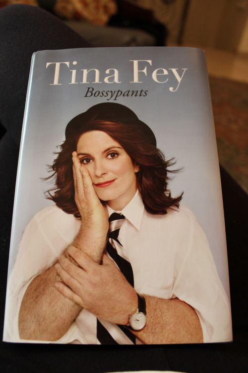 "nourareads:  Book description:  ""Before Liz Lemon, before ""Weekend Update,"" before ""Sarah Palin,"" Tina Fey was just a young girl with a dream: a recurring stress dream that she was being chased through a local airport by her middle-school gym teacher. She also had a dream that one day she would be a comedian on TV.She has seen both these dreams come true.At last, Tina Fey's story can be told. From her youthful days as a vicious nerd to her tour of duty on Saturday Night Live; from her passionately halfhearted pursuit of physical beauty to her life as a mother eating things off the floor; from her one-sided college romance to her nearly fatal honeymoon — from the beginning of this paragraph to this final sentence.Tina Fey reveals all, and proves what we've all suspected: you're no one until someone calls you bossy.(Includes Special, Never-Before-Solicited Opinions on Breastfeeding, Princesses, Photoshop, the Electoral Process, and Italian Rum Cake!) "" Favorite quotes: ""When choosing sexual partners, remember: Talent is not sexually transmittable."" ""Some people say, ""Never let them see you cry."" I say, if you're so mad you could just cry, then cry. It terrifies everyone.""  ""I am a big believer in Intelligent Design, and by that I mean I love IKEA!"" ""Whatever the problem, be part of the solution. Don't just sit around raising questions and pointing out obstacles.""  ————————————————————— At work I'm known as the girl who likes to read (sort of like Katniss Everdeen but with less flaming dresses and more books) so when I saw this at one of my colleagues desks and asked if I can borrow it (I get excited in the presence of books) he was nice enough to lend it to me. To describe this book in one sentence is to say It's a short, fun read that's good for a couple of laughs. Books like this are palette cleansers for me (I'm a pretentious idiot) and I like reading them after a classic or something that contains a sentence that I have to read several times before I know what it means. Anywhooooo, I'd recommend this to anyone looking for a light read. Ps. I hope you're not reading this  Thanks Frank for lending this to me!"