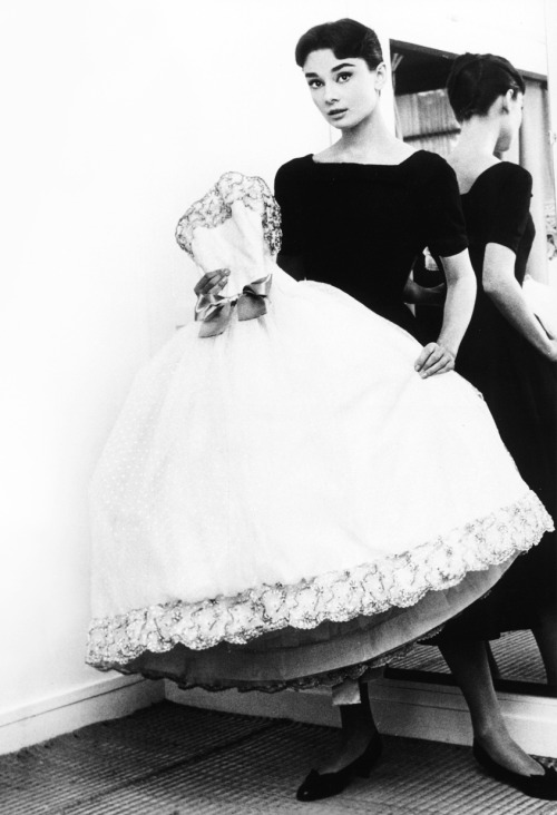 Audrey Hepburn holding the Givenchy white point d'esprit ball gown from the film Love in the Afternoon (1957)