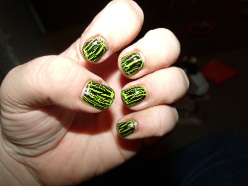 Day 4: Green Today we have Sally Hansen InstaDry in Lickety-Split Lime, topped with China Glaze's Black Crackle and a top coat of SH Double Duty.  Needless to say, I didn't get to the store to get some SV.  I also didn't shit out the money for it, so there's that too.I like how this turned out - it would be very Halloween-y with purple and orange stripes or a gradient under the black.  Hopefully my nails will get longer quickly so I can do that - I tried a 4 color gradient about a week ago and it turned out decent, but it was hard squishing all those colors on my little bitty nubbins. Today's mani was nice because it was easy - the SH InstaDry goes on somewhat thick, but it dries pretty quickly and is really a one-coat color.  WIN.  If only their top coat dried quickly as well…