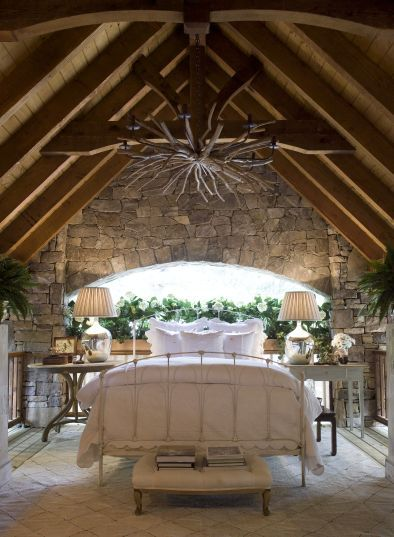 I love this puffy, white bed in this rustic room!