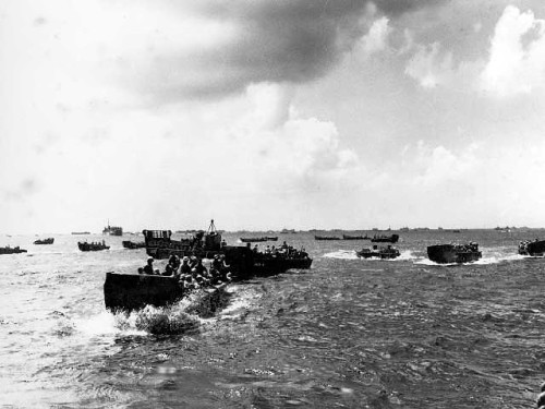 Landing craft with battle ready troops move towards Saipan beachhead.