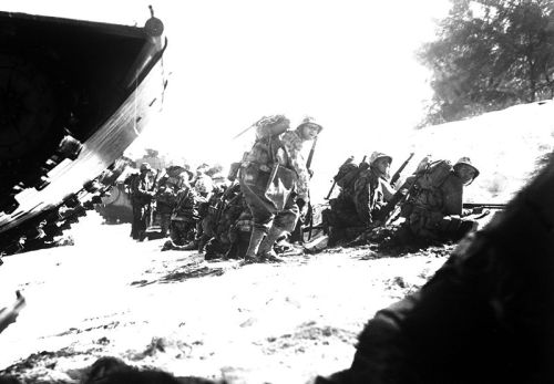 The first wave of Marines to hit the Saipan beach in the Marianas invasion take cover behind a sand dune, while waiting for the following three waves to come in. June 1944. Sgt. James Burns. (Marine Corps) Exact Date Shot Unknown . NARA FILE #: 127-N-83261 WAR & CONFLICT BOOK #: 1175