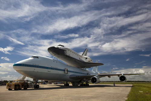Space shuttle Endeavour lifts off on final journey AP: NASA's space shuttle Endeavour left the Kennedy Space Center at sunrise Wednesday on the 1st leg of its flight to California, bolted on top of a jet. Endeavour will make it as far as Houston Wednesday, and is set to arrive in Los Angeles on Friday. This is NASA's last ferry flight of a shuttle. Endeavour flew 25 times in space before it was retired last year. Photo: Endeavour stands atop the Shuttle Carrier Aircraft ahead of its flight to Los Angeles. (NASA / Dmitri Gerondidakis)