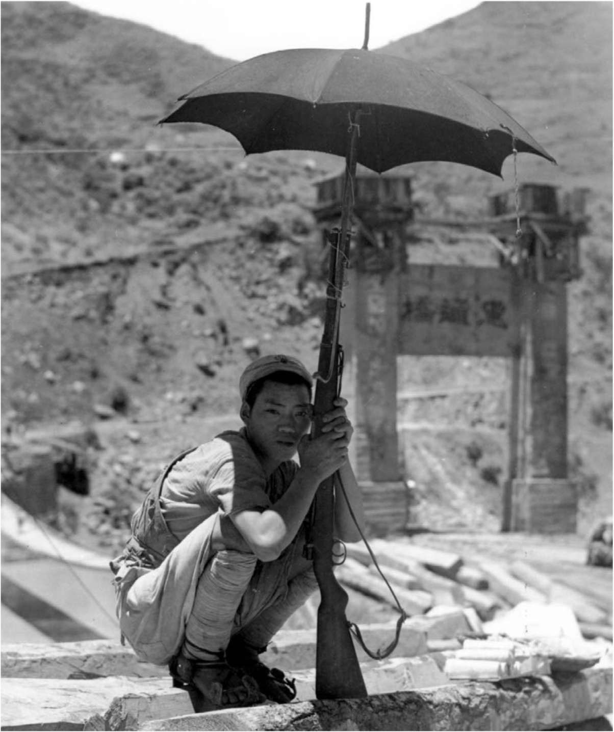 Chinese soldier on guard duty near a bridge over the Salween River, Burma, 1944