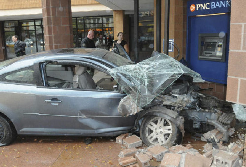 Car crashes into ATM booth