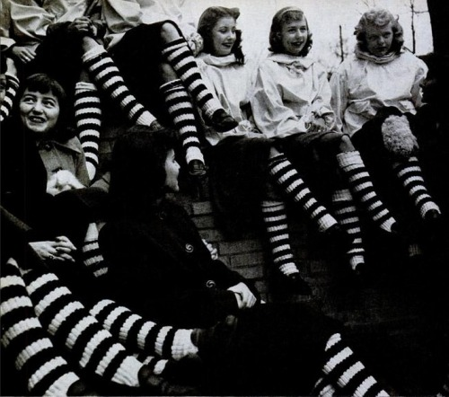 "1950sunlimited:  Teen Fads, 1948 ""Striped socks are worn by all the members of a girl's club at the Austin High School in Chicago. They are regulation football stockings which the girls have wheedled away from Austin players. The girls think they are wonderful but the boys dislike them. They say the girls legs look like Barber Poles."""
